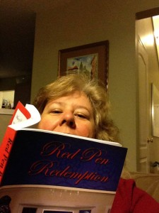 Felicia reading Red Pen Redemption while planning two weddings!